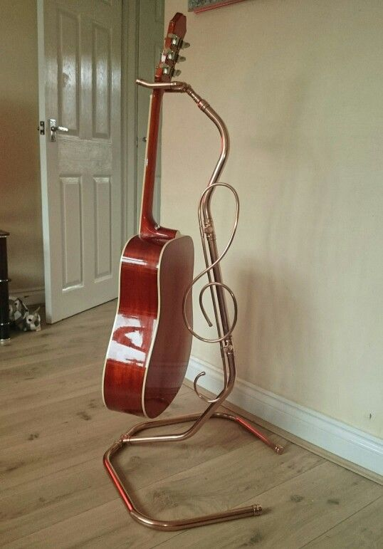 my homemade guitar stand using copper pipe treble clef detail guitarstand music to play. Black Bedroom Furniture Sets. Home Design Ideas