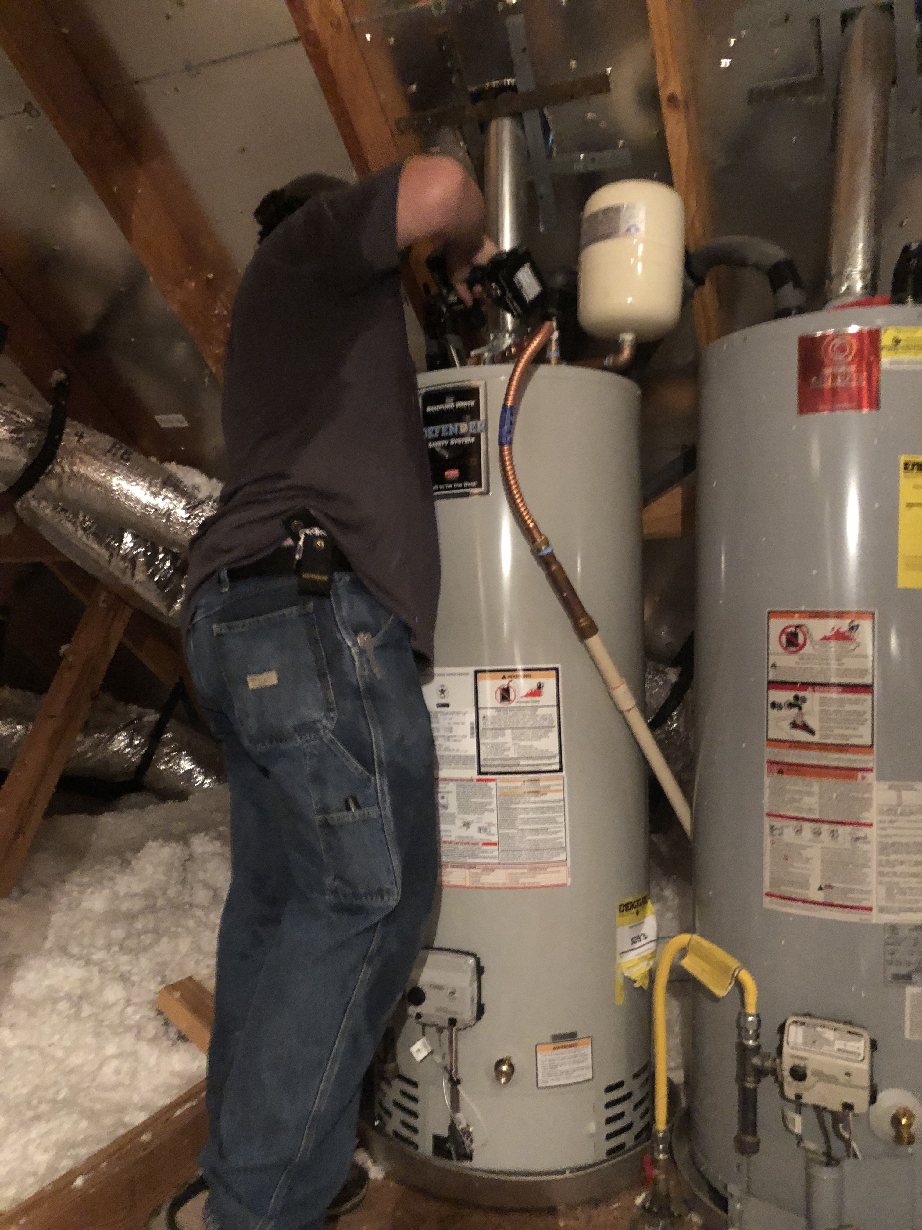 Shad Is Sweating Like Crazy Installing These Twin Water Heaters In The Attic In 90 Weather We Go The Extra Mile To Make Hot Water Heater Water Heater Heater
