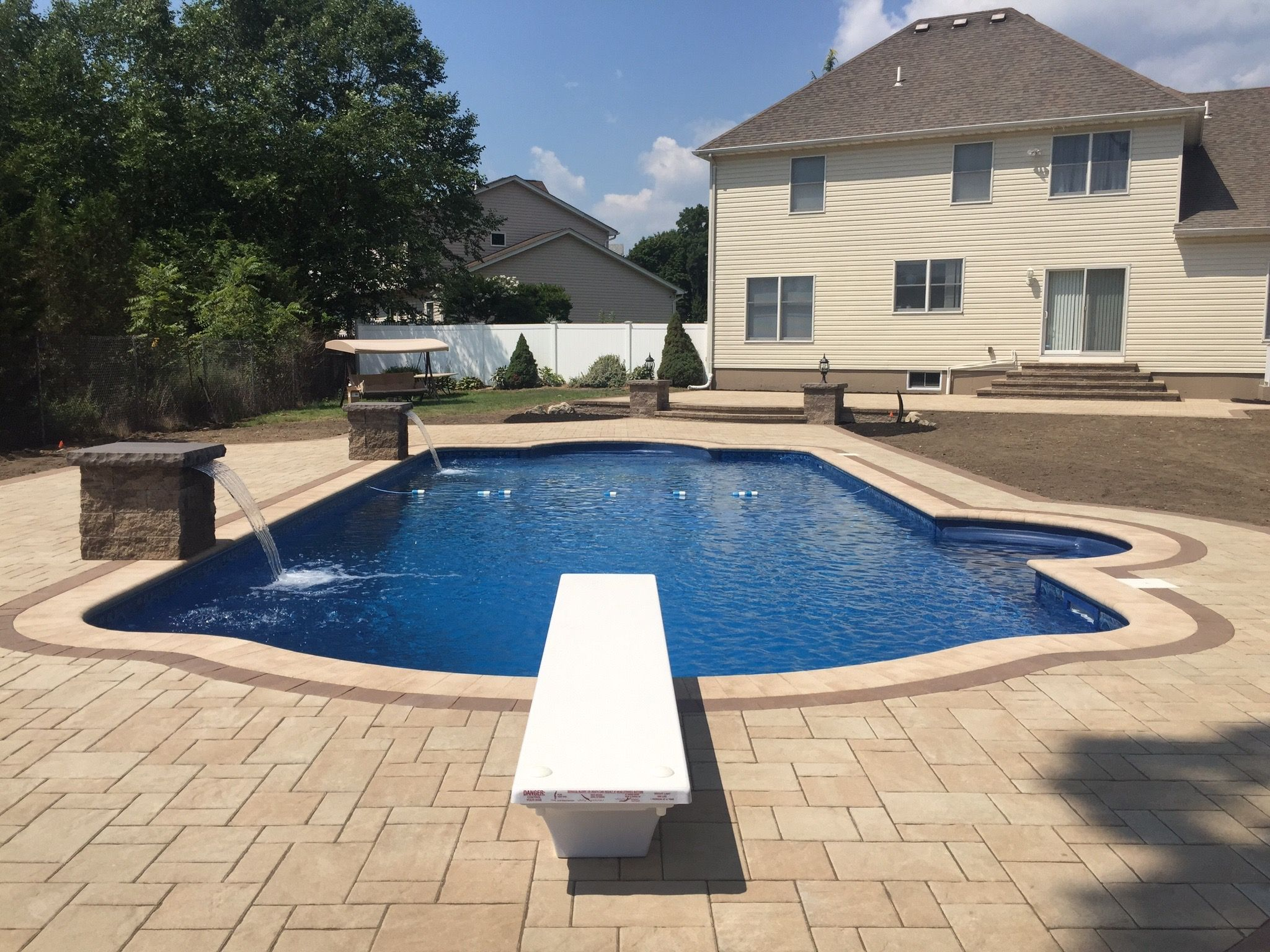 We used unilock treo pavers in tuscany for the patio and for Swimming pool surrounds design