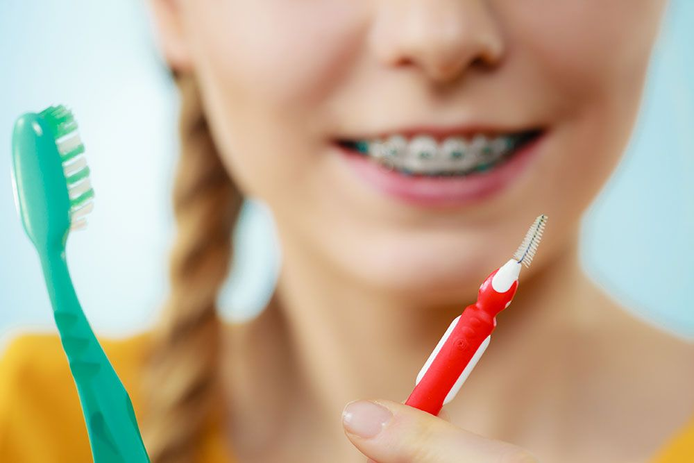 Effectively brushing and flossing with braces flossing