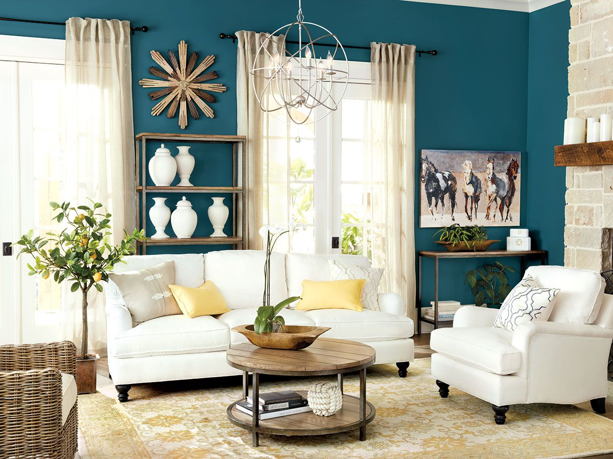 Living Rooms | Blue wall colors, Yellow throw pillows and White sofas