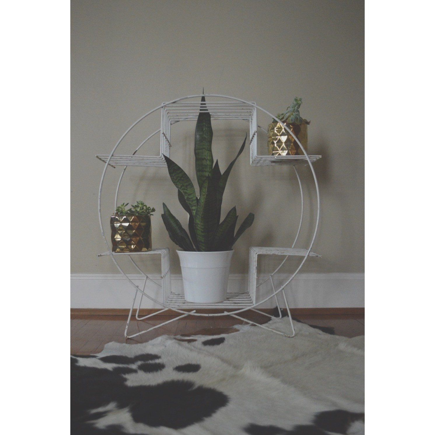 A personal favorite from my Etsy shop https://www.etsy.com/listing/287492995/vintage-mid-century-circular-plant-stand