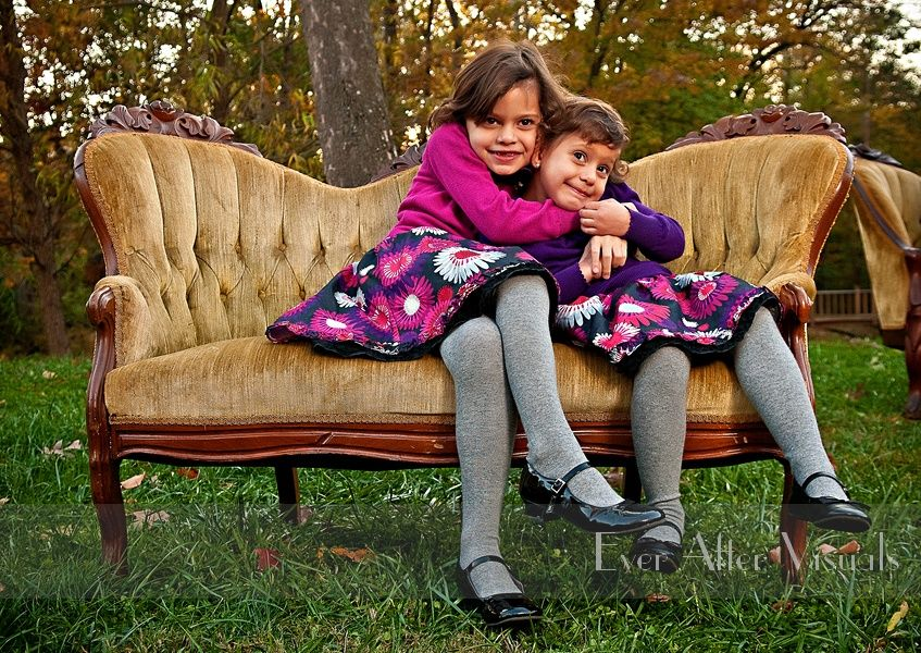 Family portrait image outside outdoor couch natural candid