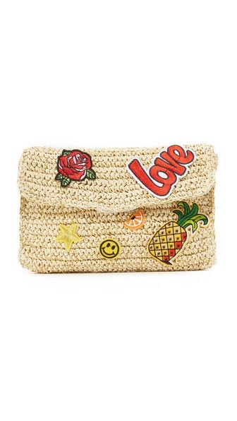 A Hat Attack clutch in woven straw, accented with an array of colorful patches - get even more style and shopping inspiration on http://jojotastic.com/shop-my-favorites/