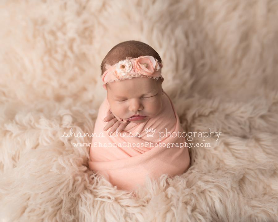 Baby girl newborn photography with peach and cream eugene oregon newborn photographer
