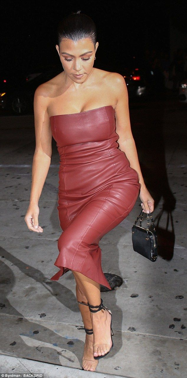 Kourtney Kardashian flaunts enviable curves in tight leather dress