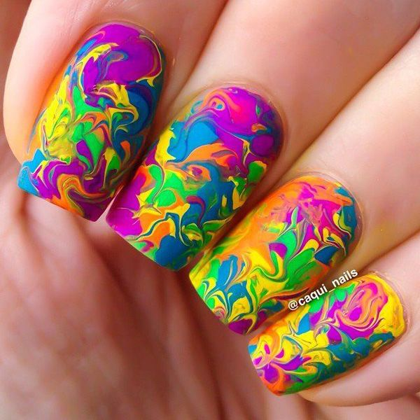 Very colorful and vibrant marble nail art theme in blue, violet, yellow, green and orange colors blended in together to create random shapes.