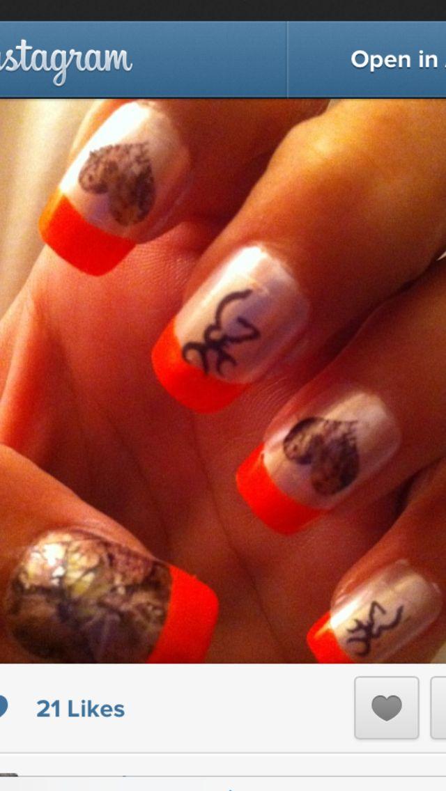 camo nails with orange tips