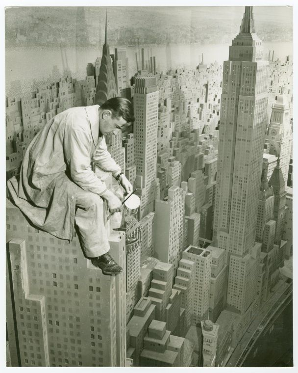 An Artist Working On A Model City Of Manhattan For The