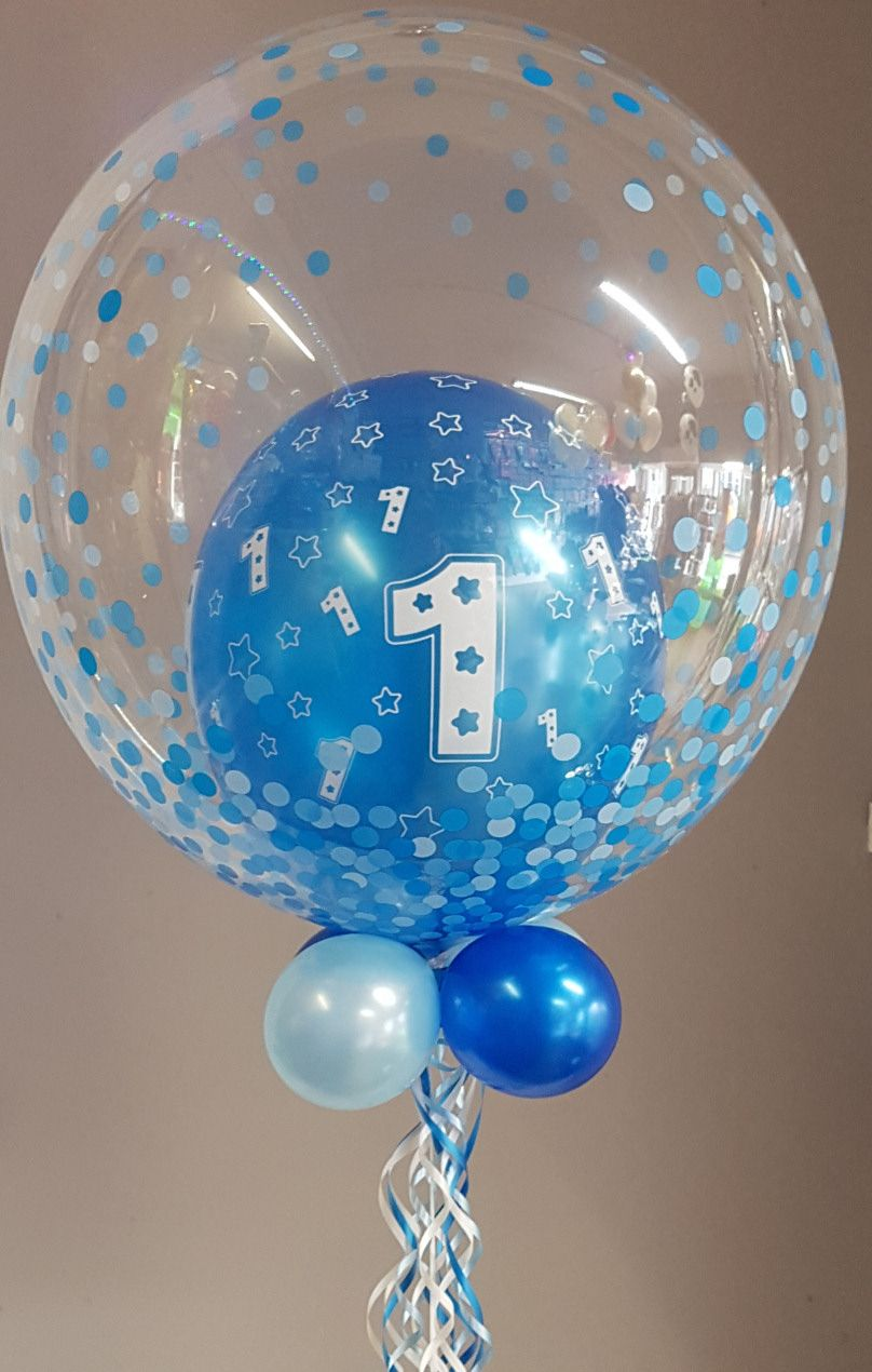 First birthday balloon in blue. Balloon in a balloon