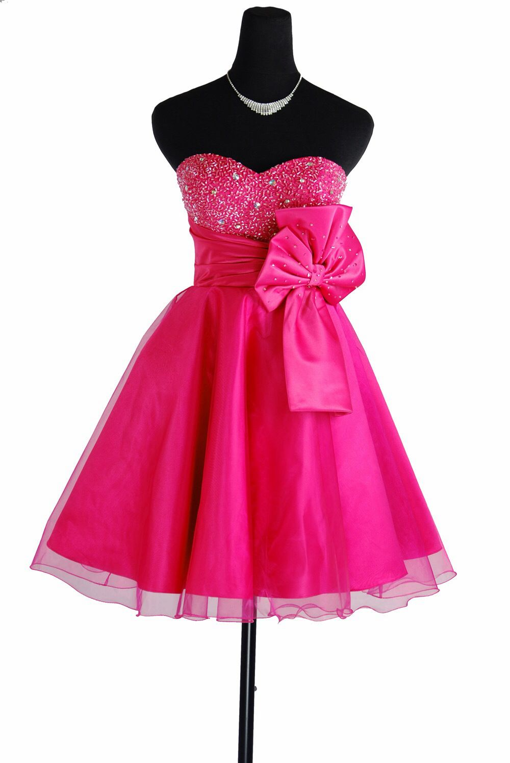 Itus a short hot pink colored dress with a belt with a bow the same