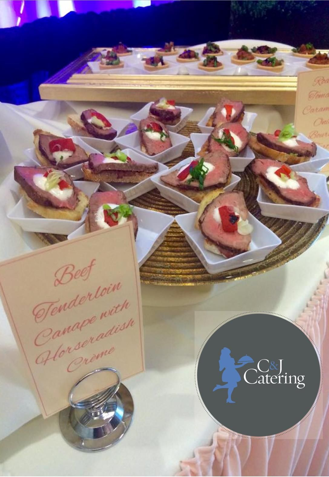 Sliced Beef Tenderloin Canape with a dollop of Horseradish Creme, Sliced Red Pepper, and Scallions.