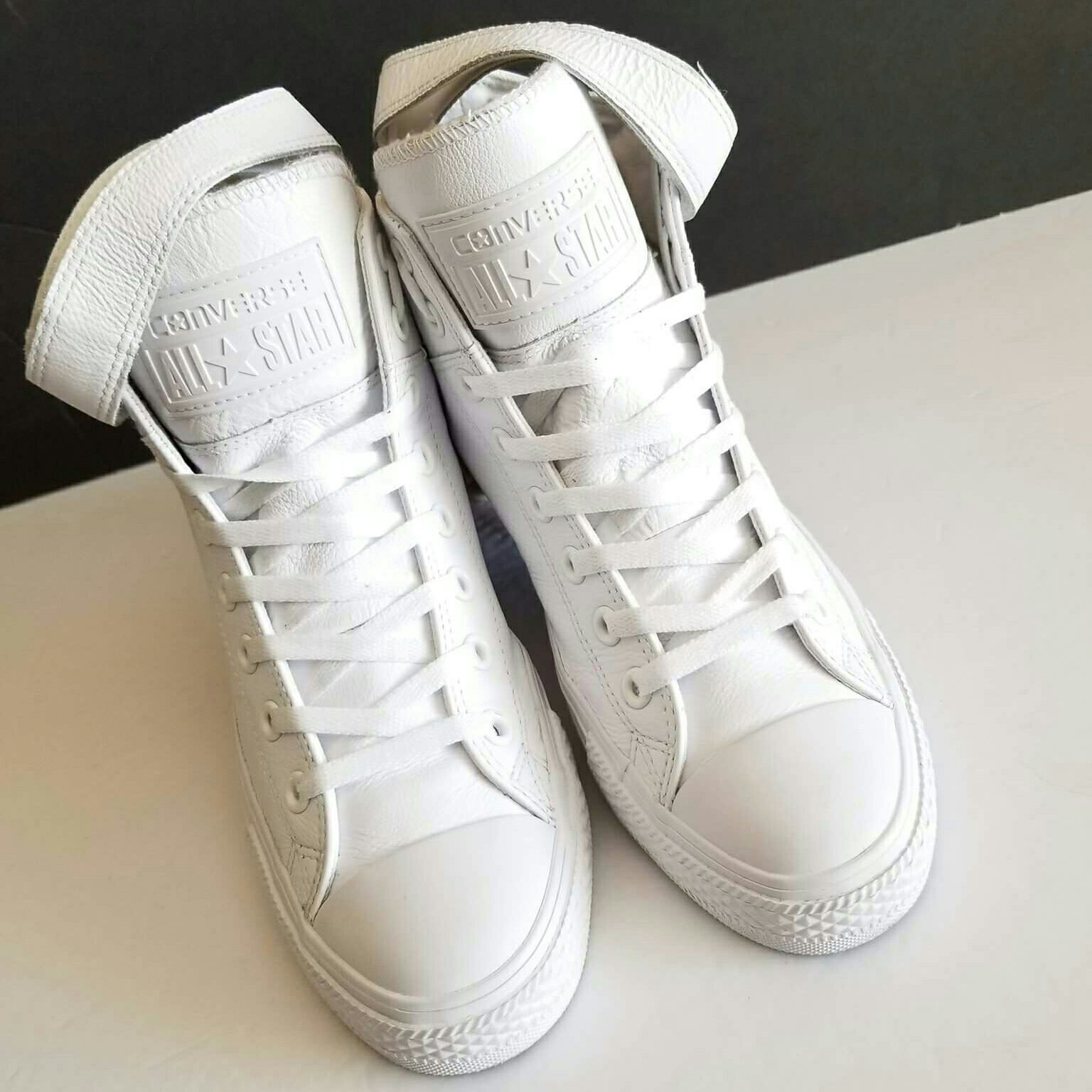 09d3a053d1c245 Converse All White Leather High Tops Super cool high top kicks with a  Velcro strap! Super fashionable Women s Size 10 Men s Size 8 In Very Good  condition!