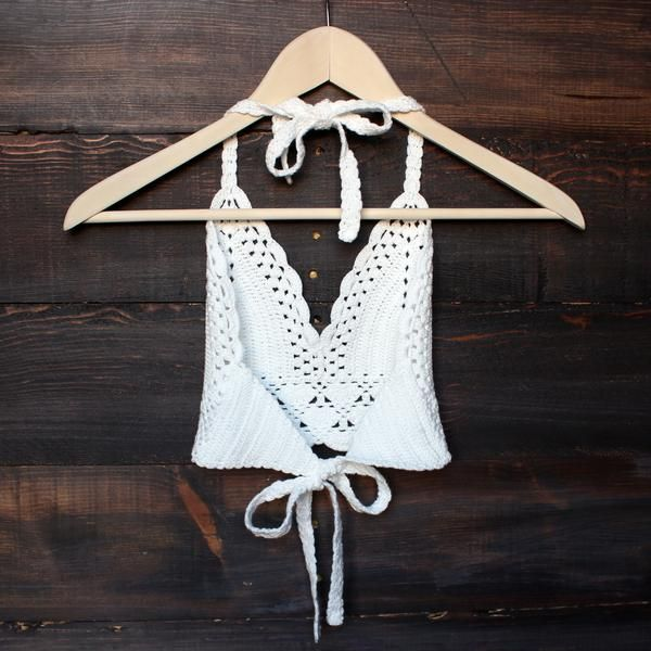 This crochet crop top radiates bohemian vibe! Beautiful halter crochet crop top featuring triangle detailing, scalloped open crochet trim at front hem and fully