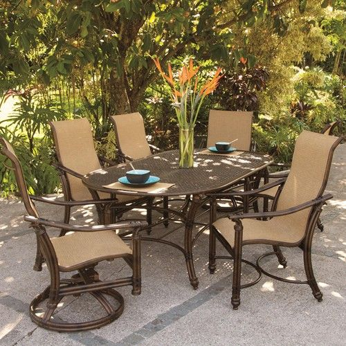 Coco Isle 7 Piece Tropical Outdoor Oval Table And Sling Chairs