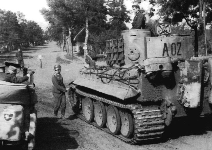 """A Tiger of Panzer-Abteilung """"Großdeutschland"""" (9. Kompanie) seems to be taking his orders along a road somewhere on the Eastern Front."""