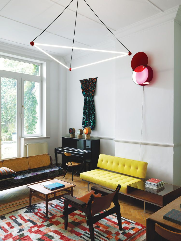 Modern Eclectic Living Room With Yellow Sofa And Red Ball Lights