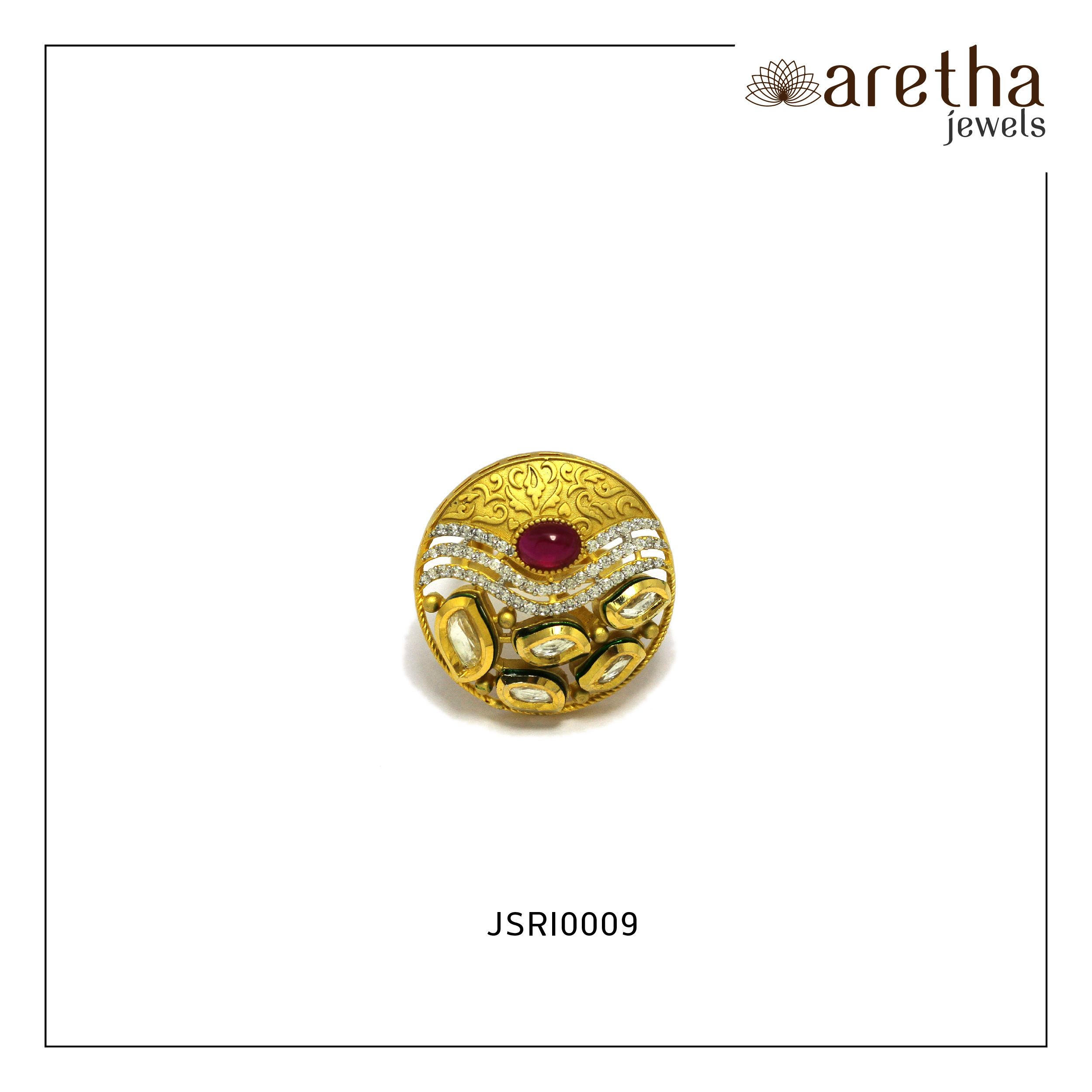 Make your engagement special with this Gold Plated Jadau Ring with Synthetic Red and White Stones Adornment.  Link: https://buff.ly/2vmB8Hi Product Code: JSRI0009 Order now by whatsapp - 7073447444 and Email :- sales@arethajewels.com #ArethaJewels #ring #jewellery #jewelry #casualjewellery #partywear #bridaljewellery