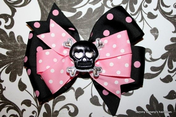 If you enjoy this bow....Skull and Cross Bones Hair Bow by Sammy Banany's Hair by iguania03, $6.99. I can use a bottle cap center, hello kitty or whatever you like.  Let me know.