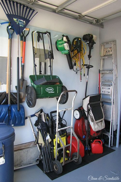How To Organize The Garage Use Wall Hooks And Floor Mats For Yard Equipment Organization