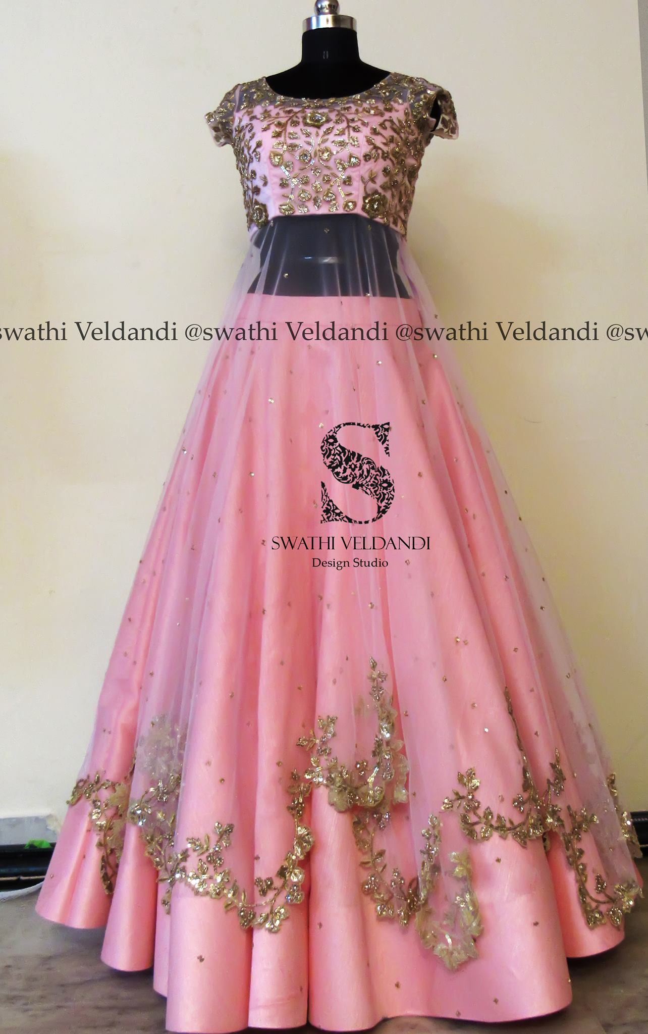 Stunning blush pink color lehenga and blouse with layered net