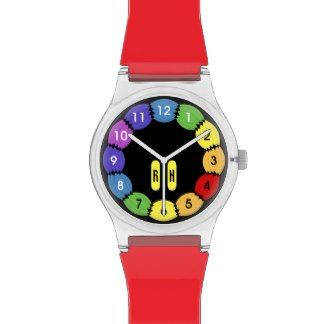 A May28th Watch with a bright colorful design that you can personalize with your initials. Seven rainbow colors on the watch face as a background to the numbers in black and white. Mix and match strap colors.
