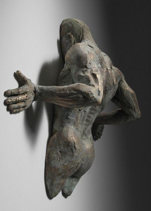 magazine sculptures stuck in walls by matteo pugliese