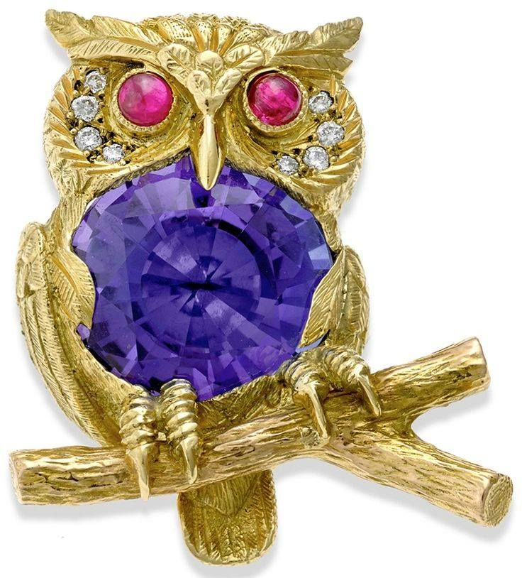 """18k Gold Owl Pin with Tanzanite, Diamonds and Ruby Eyes   •$14,950.00 -  An intricate owl pin fashioned out of 18k Gold. The bird has a grape Tanzanite center and crimson Ruby eyes, and a quartet of Diamonds (0.08 tcw) accents each side of its face. The pin measures 1"""" x 1 1⁄8"""" and is handmade in England exclusively for Scully & Scully."""