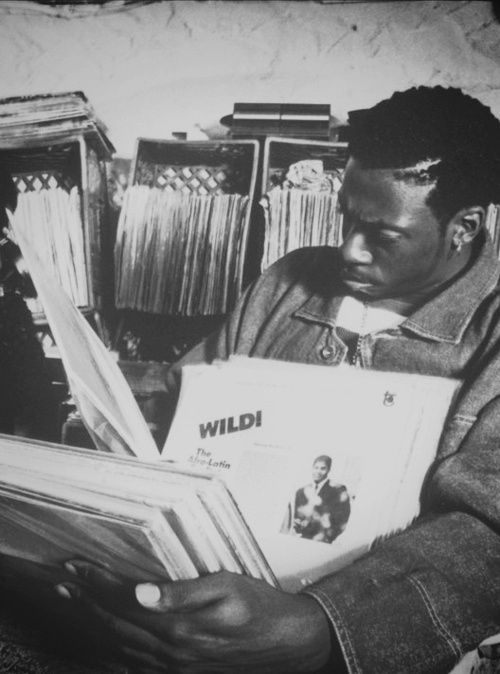 Pete Rock. Diggin'...  One of the holy beat trinity. Best bass game in hip-hop history.