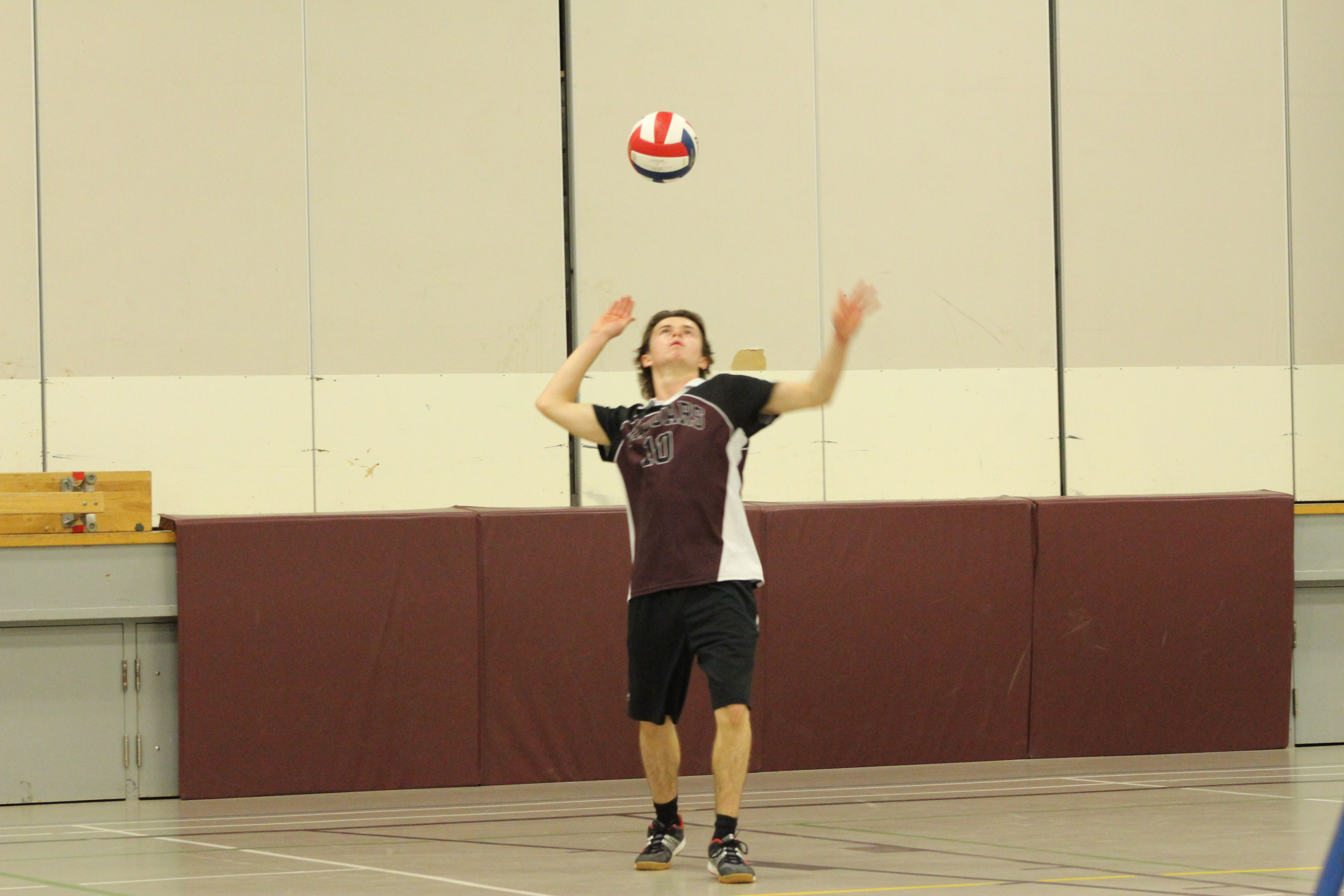 Alex Paquette From The Junior Boys Team Is About To Serve The Ball To Adhs Sports Boys Teams