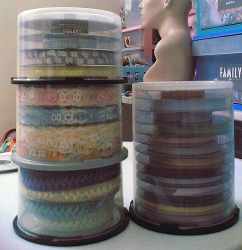 Brilliant!!! Re-use CD/DVD spindles for ribbon storage.  You could even cut a slot down the side so you could get the ribbon out without opening it every time