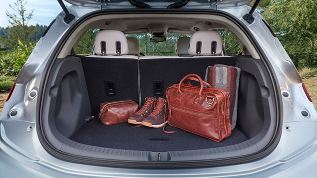 The Chevrolet Bolt Ev S Cargo Space Has A Large Capacity From Nearly 17 Cubic Feet To Over 56 When The Chevy Bolt All Electric Cars Affordable Electric Cars