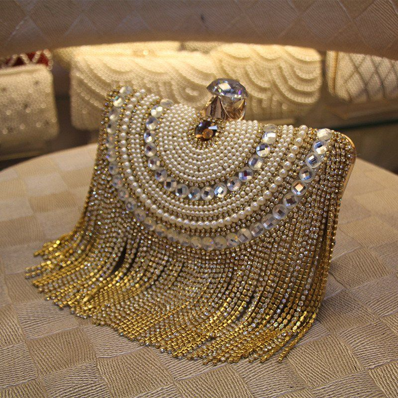 This Golden colour evening clutch is made