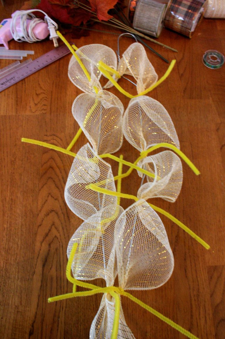 Photo of DIY deco mesh case swag wreath made with a wire hanger for under $ 10
