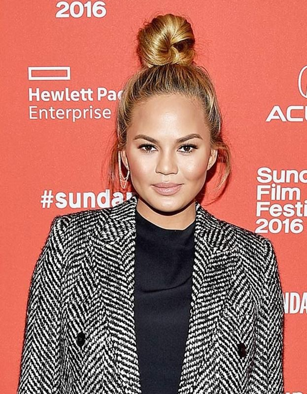 Chrissy Teigen proves that just a few ribbons of added dimension can take any hairstyle to the next level.