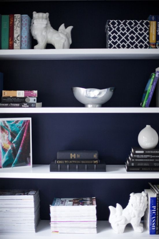 White Shelves And Accessories Against Dark Blue Walls 1234blue Godutch With Images Navy Blue Paint Colors Blue Bookshelves Navy Blue Paint