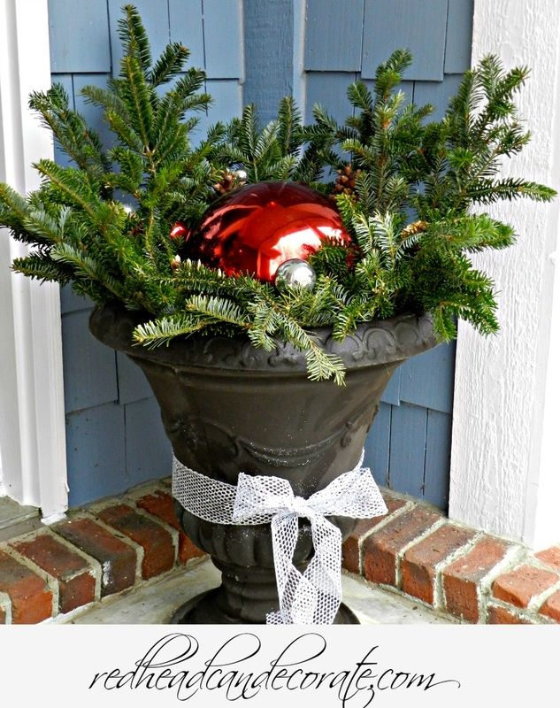 Leave your pot on your porch this Winter.  Move your gazing ball to it and fill it with Christmas tree branches.| Redheadcandecorate.com