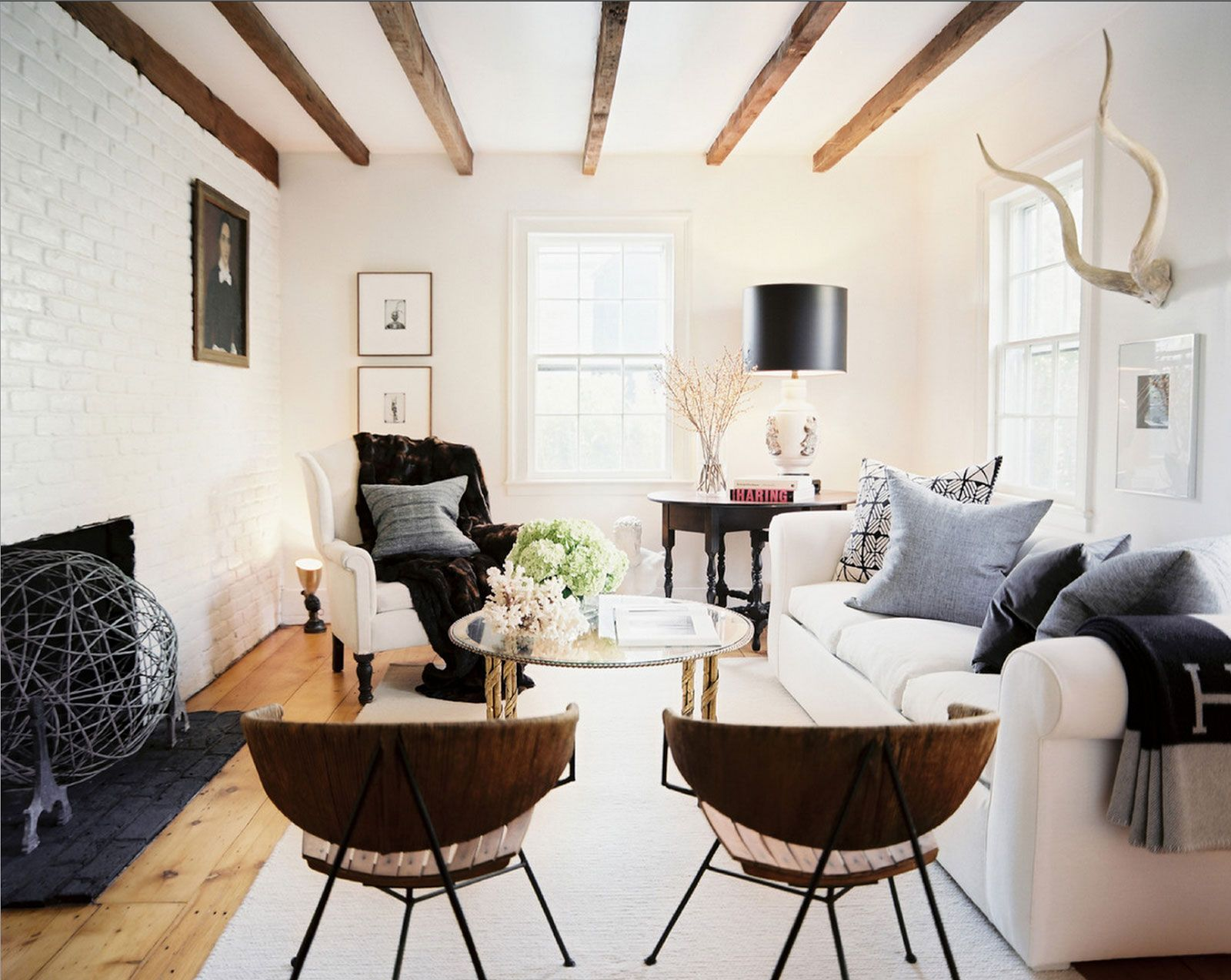 Exposed Beams, Painted Brick Fireplace Wall, Cool Chairs And A