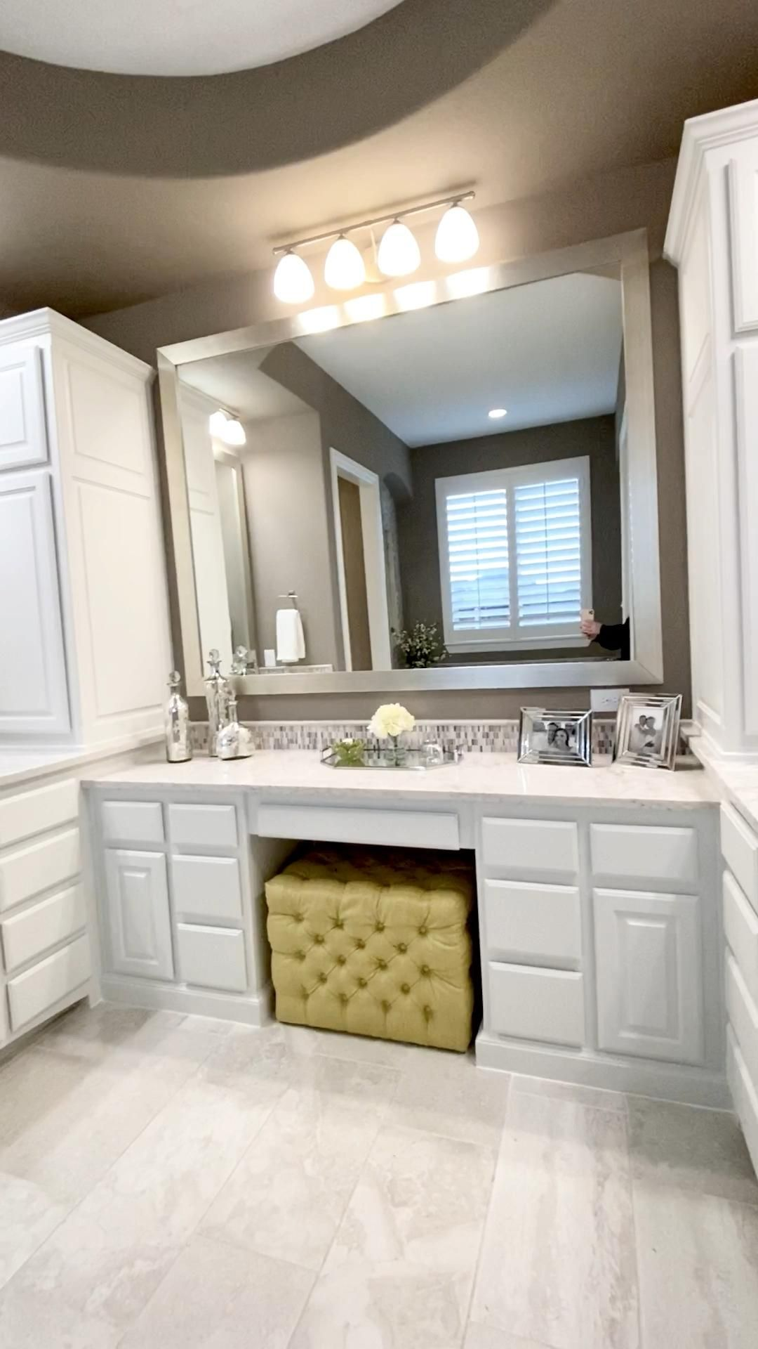 Bathroom design with white cabinets and dark taupe