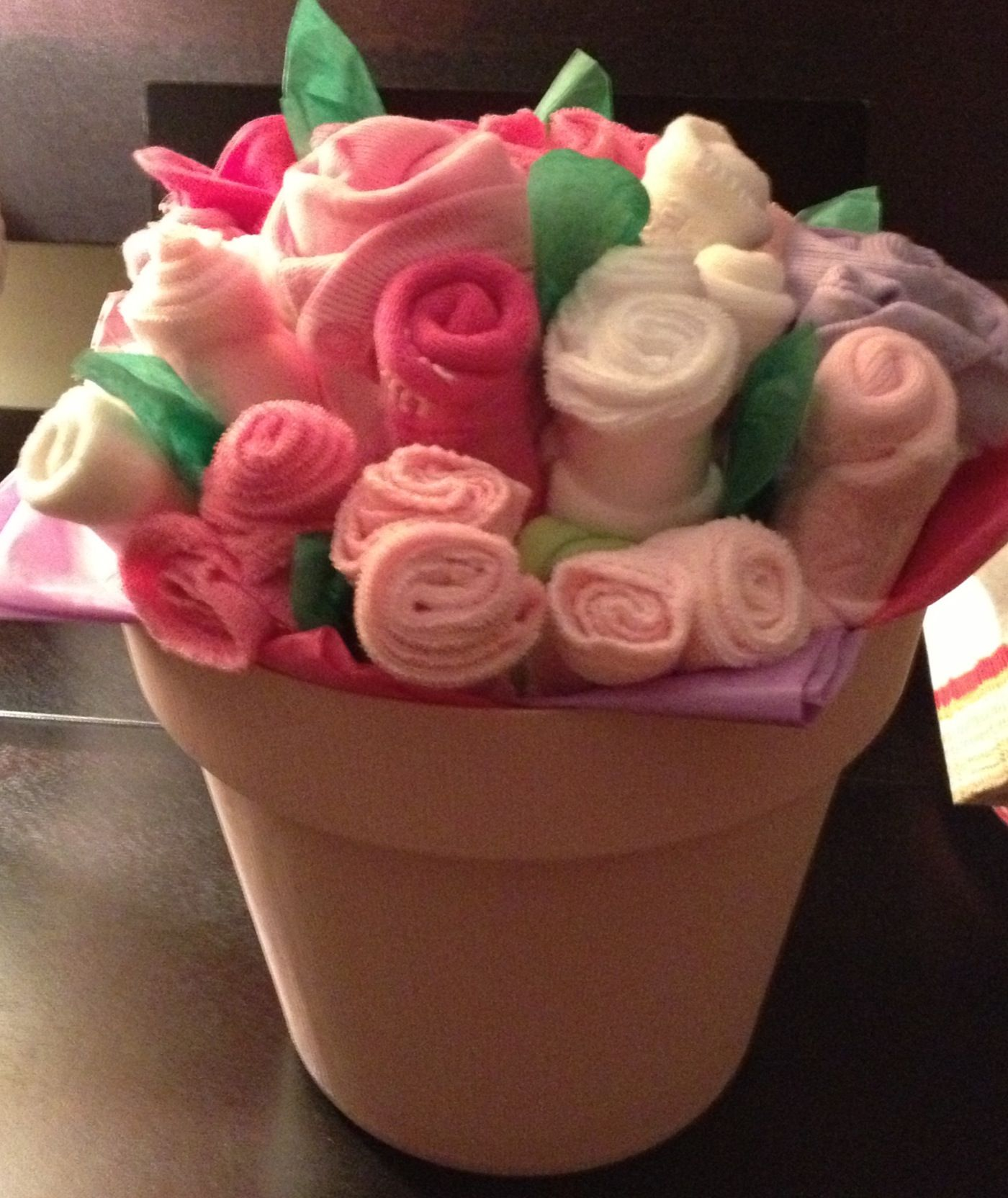 Onesie sock and washcloth bouquet homemade baby presents onesie sock and washcloth bouquet izmirmasajfo