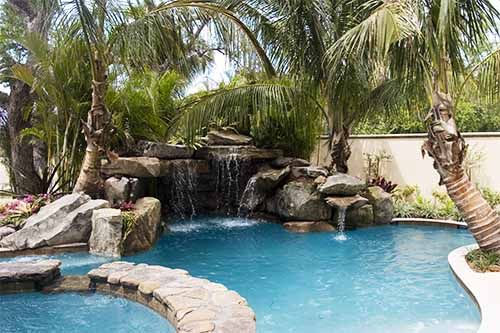lagoon pool with grotto waterfall spa and fire pit - Lagoon Swimming Pool Designs