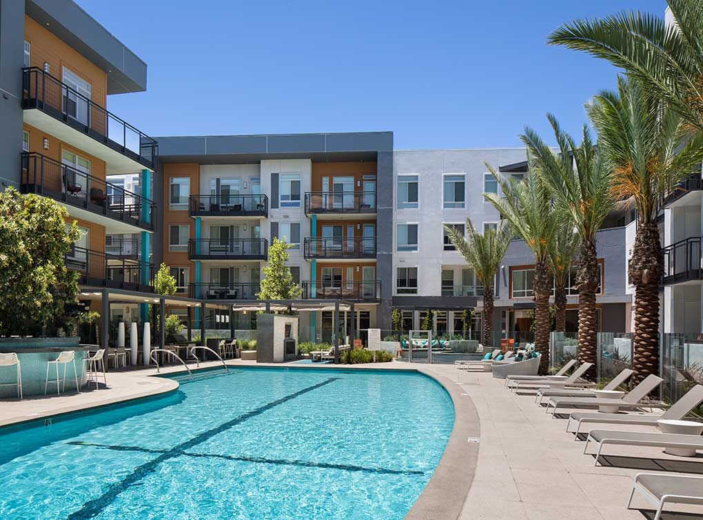 The Pool At Amli Uptown Orange In Orange Ca Is Immaculately Landscaped Looking For Apartments Uptown House Styles