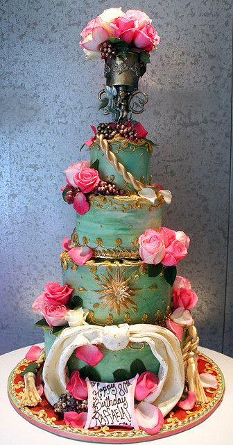 Tiered wedding cake with French rococo theme. Buttercream and white chocolate decoration.