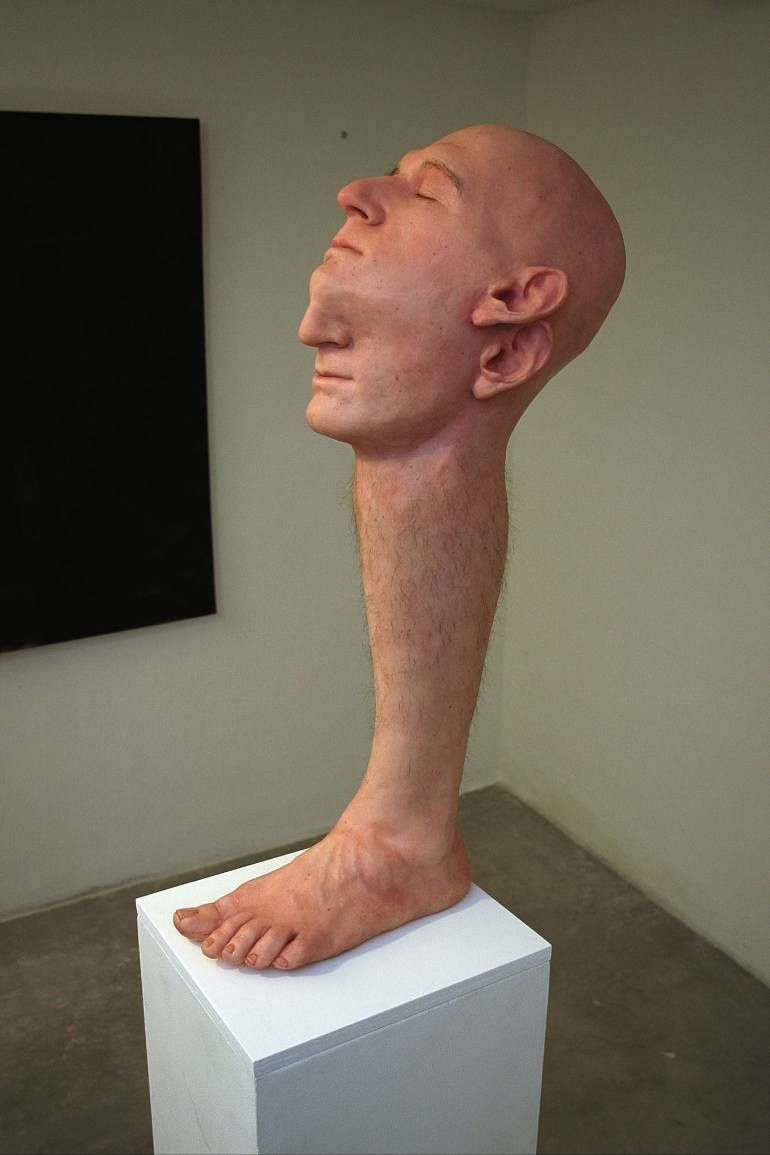 Photo of Realistic sculptures of free-floating body parts, 'humans' trapped in formal…