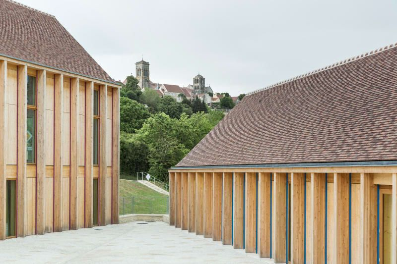 Bernard Quirot architecte + associés, Luc Boegly · Maison de santé à - Maison En Bois Sur Pilotis