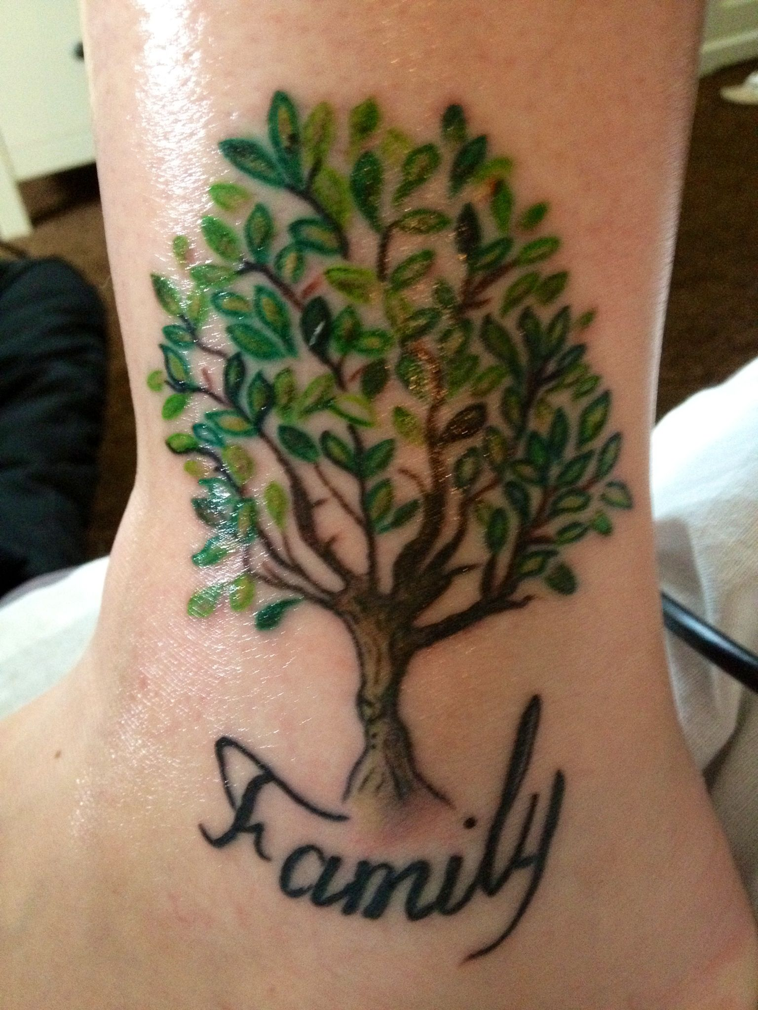 Family first with a rose arm tattoo done by kurt stanley