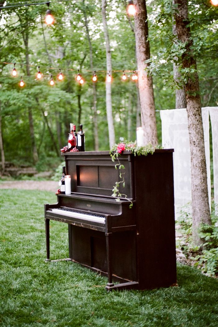 FOR THE RECEPTION Upright piano outdoors for first
