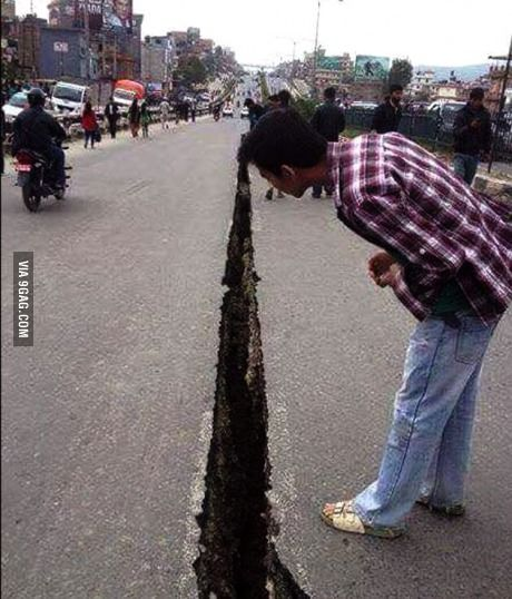The way this road split on the divider line in tragic Nepal earthquake.