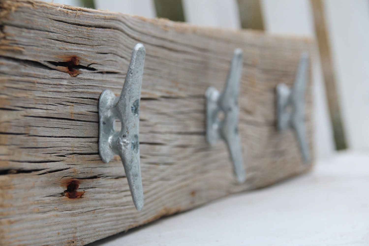 I can do this without spending $40...Nautical coat rack with boat cleats, made from reclaimed wood. $39.99, via Etsy.