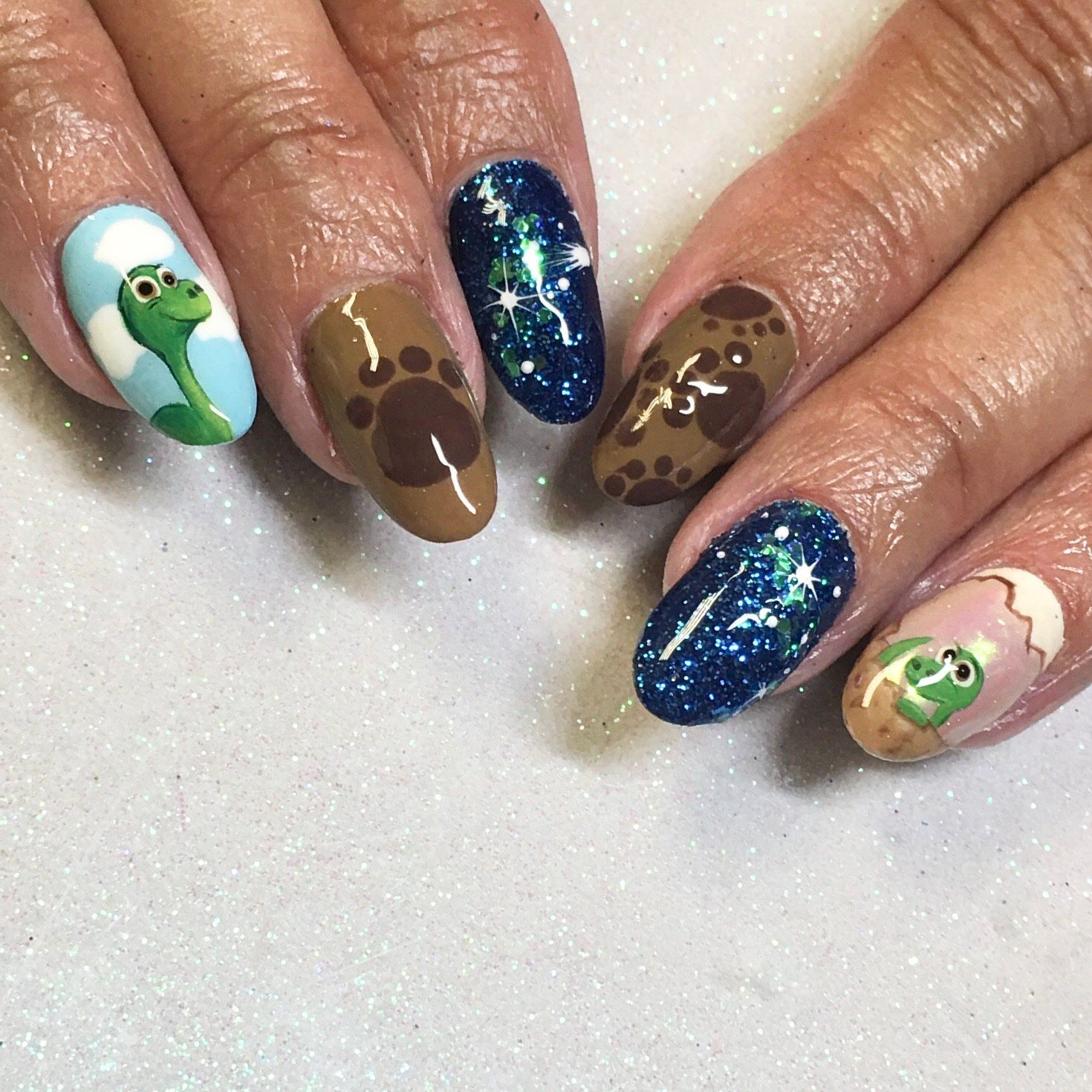 The good dinosaur nails are the perfect compliment to baby Argos christening. #using @ikoniqnailsuk #primagelpolish #showscratch